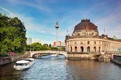 The Bode Museum on the Museum Island in Berlin, Germany. Tourist ship on River Spree