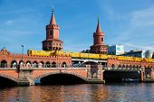 The Oberbaum Bridge, German Oberbaumbrucke and River Spree in Berlin, Germany. U-bahn going through the bridge