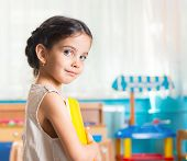 stock photo of daycare  - Beautiful little latin girl portrait in daycare - JPG