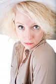 foto of coy  - One coy blond female on white background - JPG