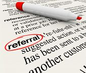 stock photo of recommendation  - The word Referral circled in a dictionary showing its definition as a reference or receommendation by a customer or employer - JPG