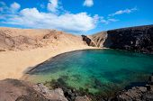 picture of papagayo  - Papagayo Beach in Lanzarote Canary Islands with clouds in the sky - JPG