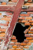 Hole In A Red Brick Wall