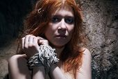 picture of catacombs  - redheaded nude woman bondage in catacomb - JPG