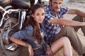 Biker Man And Girl Sits