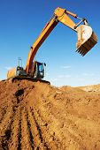 loader excavator machine doing earthmoving work at sand quarry