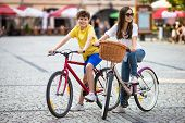 Urban biking - teens and bikes in city