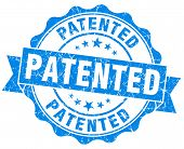 image of plagiarism  - patented grunge blue stamp on white background - JPG