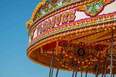 image of merry-go-round  - Close up of the word pleasure on a merry go round - JPG