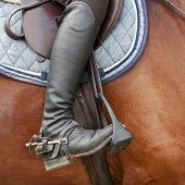 Close Up Of Jockey Riding Boot, Horses Saddle And Stirrup