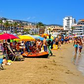 PENISCOLA, SPAIN - JULY 26: Bathers in North Beach on July 26, 2013 in Peniscola, Spain. The town is