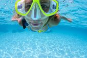 Close up shoot of the woman snorkeling in a tropical sea