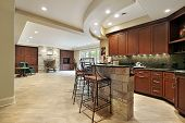 foto of stone floor  - Lower level with fireplace and kitchen with stone bar
