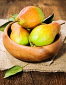 Ripe Pears In A Wooden Bowl