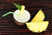 foto of pina-colada  - Pina colada drink in coconut - JPG