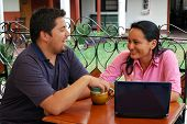 Hispanic Couple And Laptop