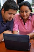 Young Hispanic Couple On A Laptop Together