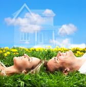 stock photo of dream home  - Young love couple smiling dreaming about a new home - JPG