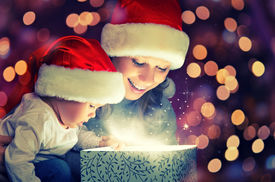 image of new years baby  - Christmas magic gift box and a woman happy family mother and Child baby - JPG