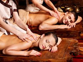 stock photo of panchakarma  - Couple  having oil Ayurveda spa treatment - JPG