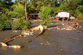Abandoned Boat Near Village House At Low Tide Ocean Coast