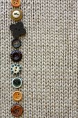 Row Of Vintage Buttons Lined Up On Soft Fabric Background