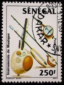 SENEGAL - CIRCA 1985: A stamp printed by Senegal, shows Rabab, shawm and fiddles, circa 1985