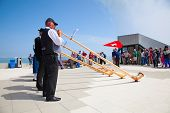 MOUNT PILATUS - JULY 13: Unidentified people playing traditional swiss music with alphorns on July 13, 2013 on the top of Pilatus, Switzerland. Alphorn is traditional music instrument of Switzerland.