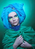 Young woman in blue turban