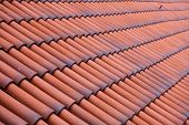 stock photo of red roof tile  - Red tiles roof texture architecture background detail of house close up - JPG