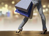 Walking shopping woman holding bag on the city square close up