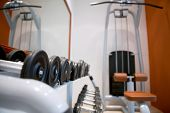 Weights, many black dumbbell in fitness room at gym