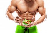 Fit Man Holding A Fresh Salad Bowl