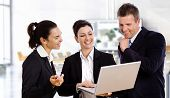 picture of work crew  - Happy business people with laptop working together laughing - JPG