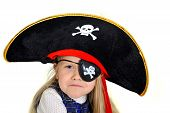 foto of pirate hat  - Cute little 5 years old blonde girl playing in pirate hat and eyepatch isolated on white background - JPG