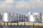 stock photo of refinery  - big Industrial oil tanks in a refinery - JPG