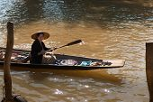 Floating Asian Vendors On Long Wooden Boat