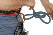 sport climber is binding a knot