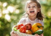 girl holding a fresh vegetables