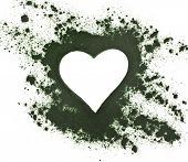 Spirulina powder - algae, nutritional supplement,  shape heart surface top view  isolated on white b