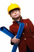 Little boy with plans and toolbox playing engineer role