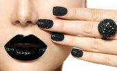 Beauty Black Caviar Manicure and Black Lips. Fashion Makeup and Manicure. Dark lipstick. Nail Art. B