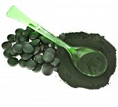 pic of green algae  - Spirulina algae  powder and tablets in spoon  - JPG