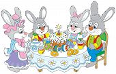 foto of fancy cakes  - Family of rabbits celebrating Easter at the holiday table with a fancy holiday cake and colorfully painted eggs - JPG
