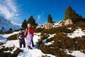Family (mother With Two Children) Take A Walk On Winter Mountain Slope (big Almaty Lake, Kazakhstan)
