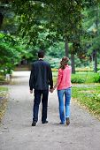 Man And Woman On A Walk In Park