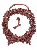 Clock shaped coffee beans isolated on white