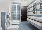 image of shower-cubicle  - Modern bathroom in blue and gray tones with shower cubicle on wide angle view - JPG