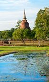 Ruins Of Buddhist Stupa Or Chedi In Sukhothai Historical Park In Wat Chana Songkhram Temple Near Pon