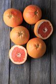 Ripe grapefruits on wooden background